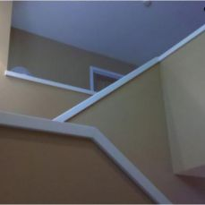 stairway with white railing
